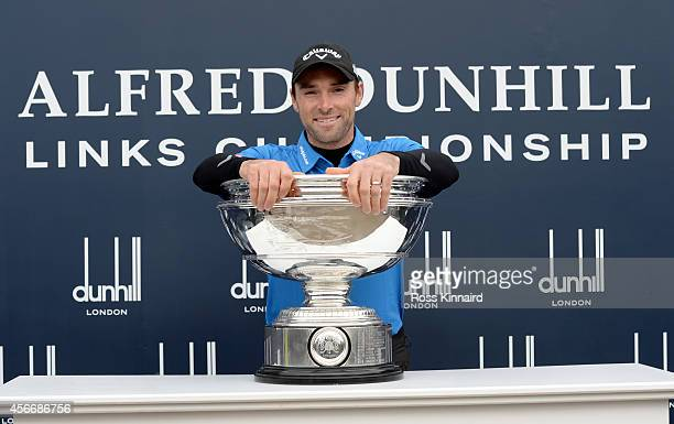 Oliver Wilson of England poses with trophy after victory in the 2014 Alfred Dunhill Links Championship at The Old Course on October 5 2014 in St...