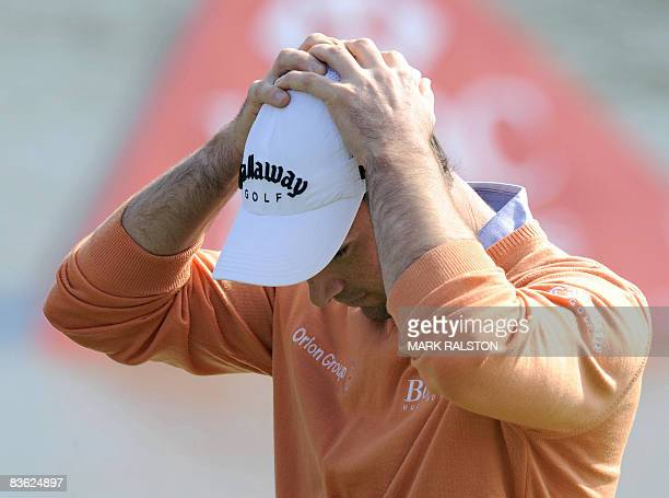Oliver Wilson of England reacts after losing the playoff on the 18th hole during the HSBC Champions golf tournament at the Sheshan International...