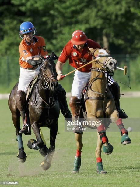 Oliver Winter of team Darboven competes with Santos Anca of team Deilmann during the Polo Berenberg Derby on May 27 2005 in Hamburg Germany