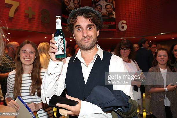 Oliver Wnuk with a Babo blue beer during the premiere for the film 'Maennertag' at Mathaeser Filmpalast on September 5 2016 in Munich Germany