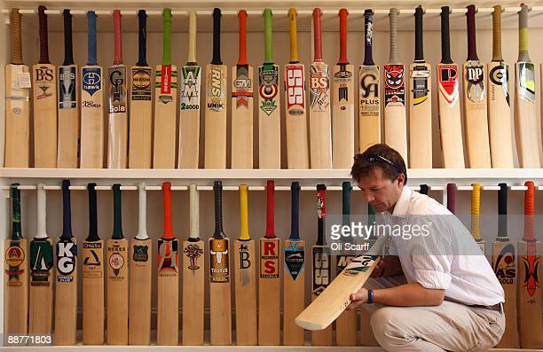 Oliver Wright a Director at JS Wright Sons examines some of the finished cricket bats made by the companies he supplies with willow clefts on June 30...