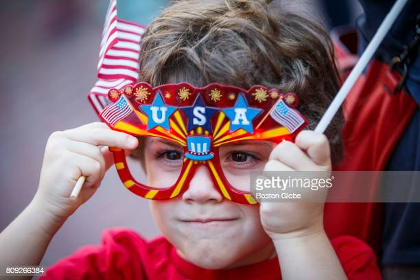 Oliver Ziff adjusts his novelty glasses during Independence Day commemoration ceremony in Boston on Jul 4 2017