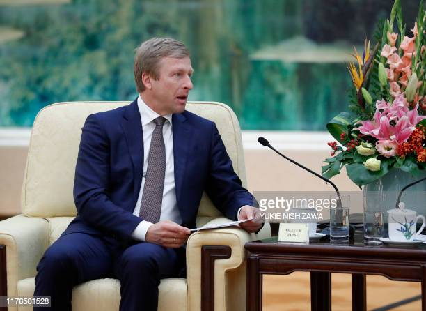 Oliver Zipse chairman of the management board of BMW Group meets with Chinese Premier Li Keqiang at the Great Hall of the People in Beijing on...