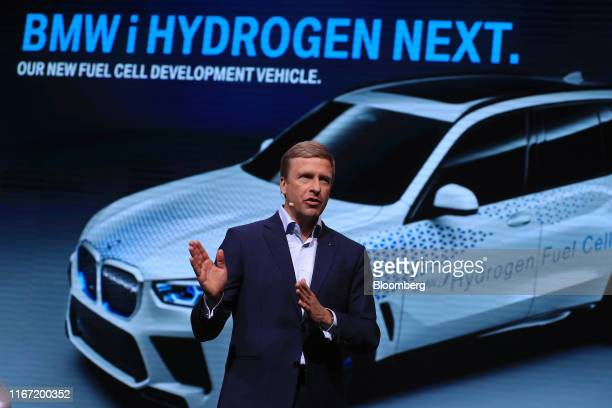 Oliver Zipse chief executive officer of Bayerische Motoren Werke AG gestures while speaking during a news conference on the opening day of the IAA...