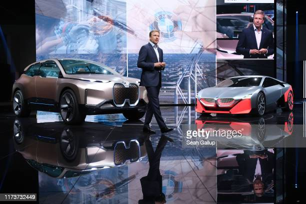 Oliver Zipse head of BMW speaks while standing next to the BMW iNEXT and M NEXT concept cars during the press days at the 2019 IAA Frankfurt Auto...