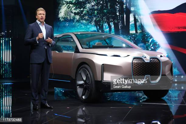 Oliver Zipse head of BMW speaks while standing next to the BMW iNEXT concept car during the press days at the 2019 IAA Frankfurt Auto Show on...