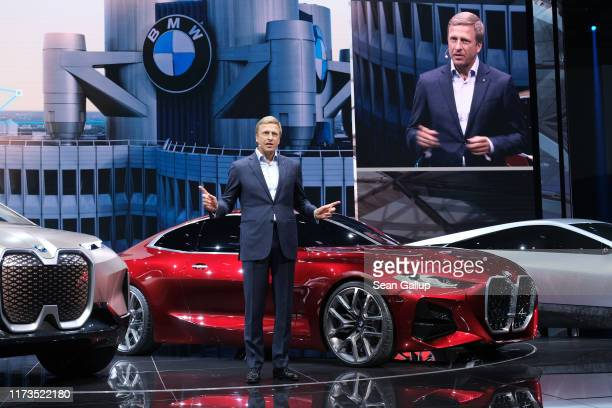 Oliver Zipse, head of BMW, speaks while standing next to the new BMW Concept 4 Coupe during the press days at the 2019 IAA Frankfurt Auto Show on...