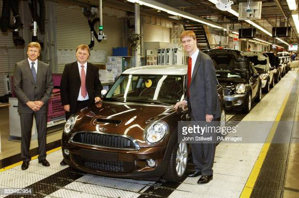 Oliver Zipse Managing Director of BMW Group Plant Oxford Andrew Smith MP Oxford East and Competitiveness Minister Stephen Timms at the end of the...