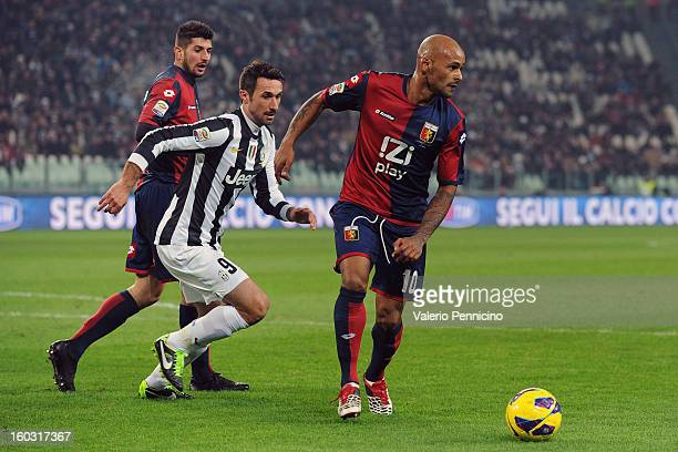 Olivera of Genoa CFC in action against Mirko Vucinic of FC Juventus during the Serie A match between FC Juventus and Genoa CFC at Juventus Arena on...