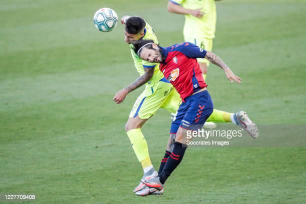 Olivera of Getafe CF Unai Garcia of CA Osasuna during the La Liga Santander match between Osasuna v Getafe at the Estadio El Sadar on July 5 2020 in...