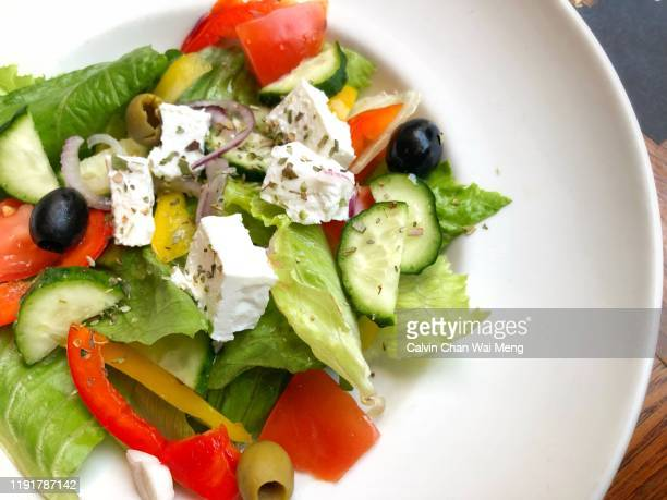 olives and green salad - mediterranean culture stock pictures, royalty-free photos & images