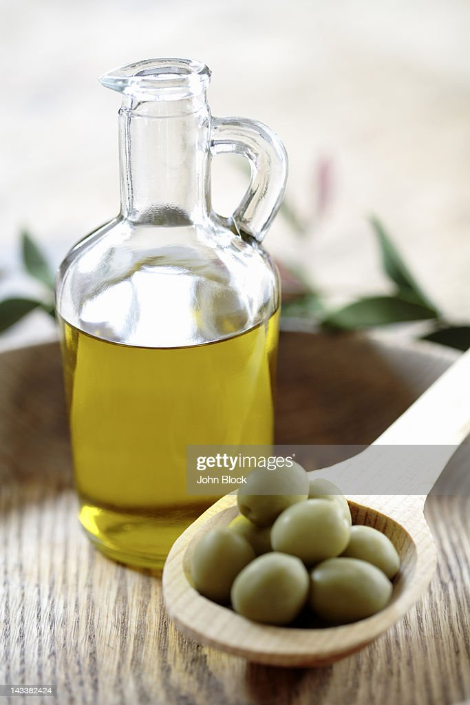Olives and olive oil in jug : Stock Photo