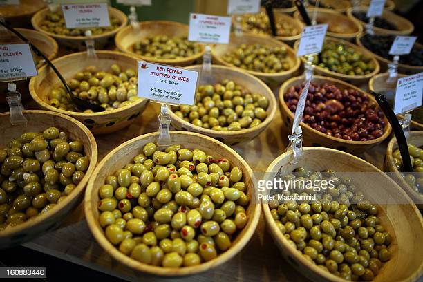Olives are displayed for sale for sale at Borough Market on February 7 2013 in London England Borough Market London's oldest since 1756 has recently...