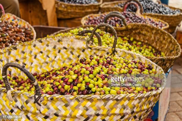 olives at a market in fez morocco - cristian neri foto e immagini stock