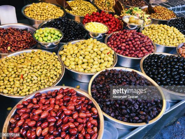 olives for sale on a market stall at carmel market, tel aviv, israel - tel aviv foto e immagini stock