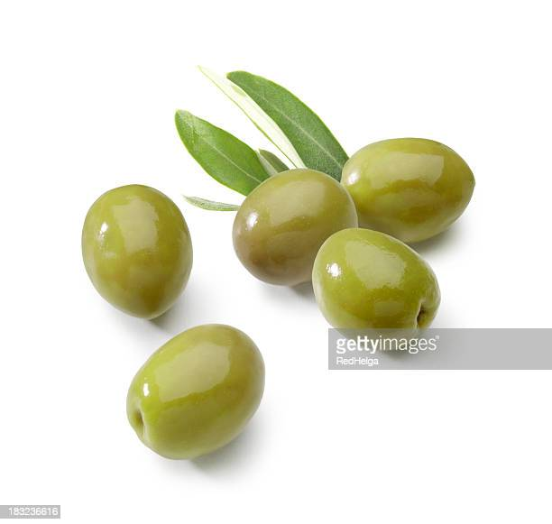olives green with leafs - green olive stock photos and pictures
