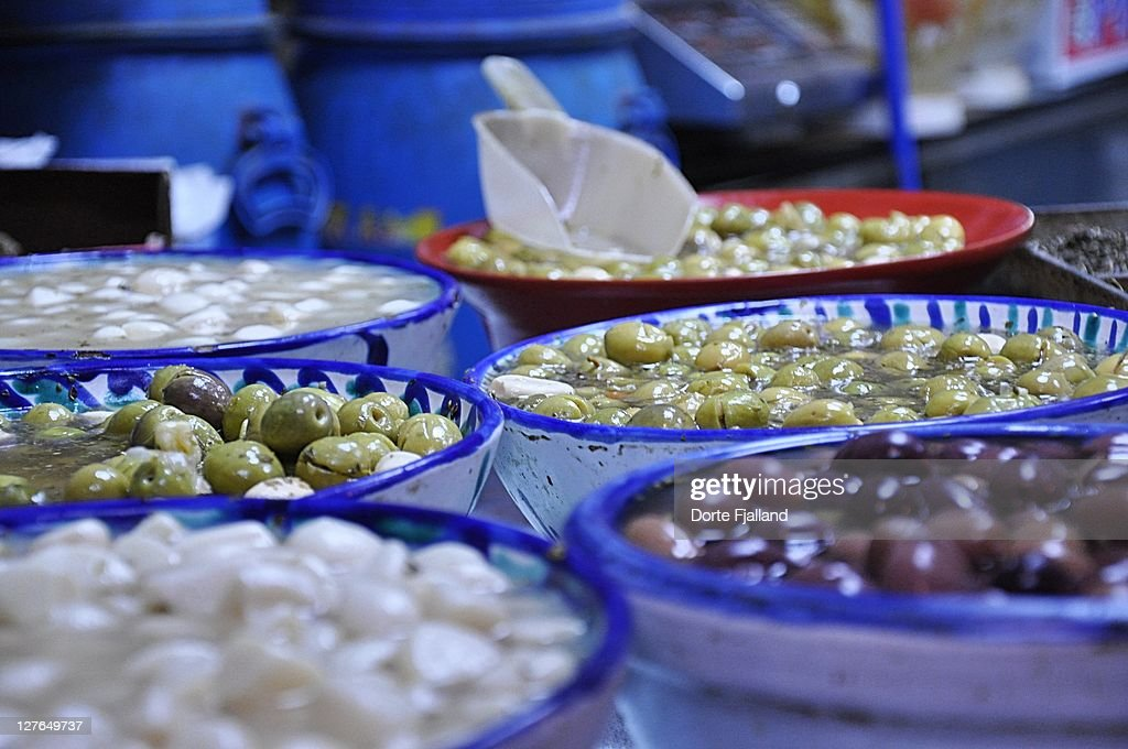 Olives in blue and white ceramic bowls : Stock Photo