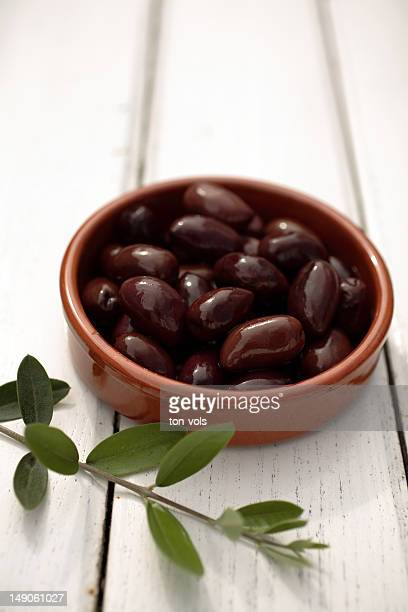 olives on a table with branch - kalamata olive stock pictures, royalty-free photos & images