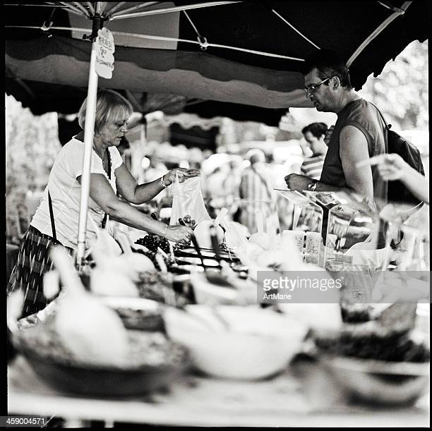 olives seller - black and white vegetables stock photos and pictures