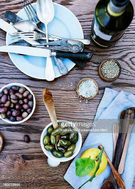 Olives, spices and wine on table