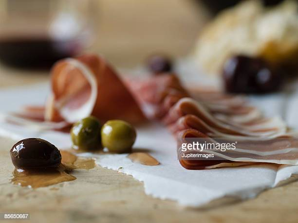 Olives with raw meat slices