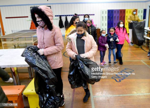 Olivet club members head out to the neighborhood to pickup trash. At the Olivet Boys and Girls Club Mulberry Street location in Reading Monday...