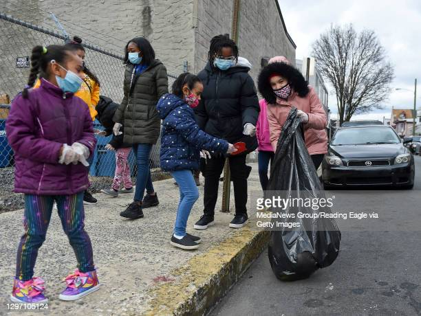 Olivet club members pickup trash on Mulberry Street outside the club. At the Olivet Boys and Girls Club Mulberry Street location in Reading Monday...