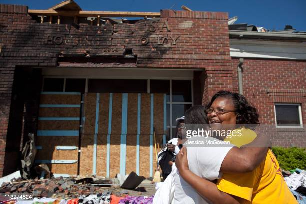 Olivia Allen with the Adventist Community Services Disaster Response team hugs Janet Price with relief to see her safe, in the Rosedale neighborhood...