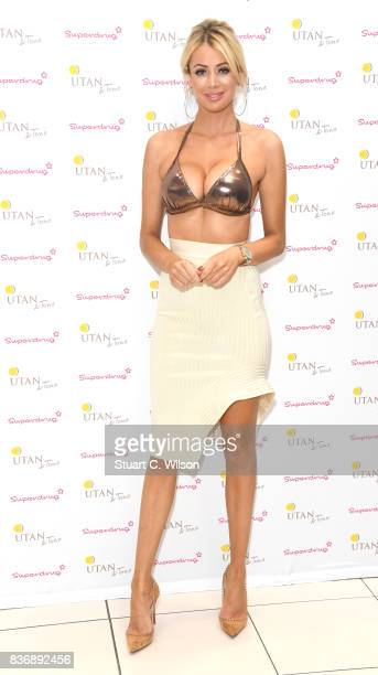 Olivia Attwood celebrates the nationwide launch of 'UTan Tone' into Superdrug stores at Superdrug Westfield White City on August 22 2017 in London...