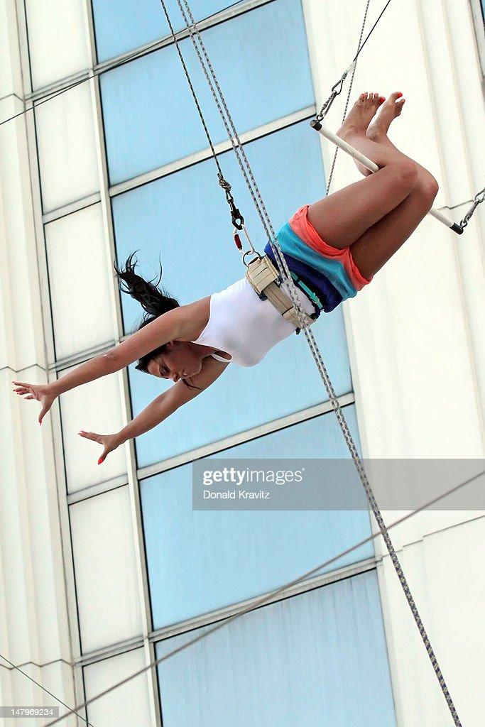 Olivia Blois Sharpe performs on trapeze at Trump Taj Mahal on July 6, 2012 in Atlantic City, New Jersey.