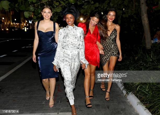 Olivia Brower Halima Aden Kelsey Merritt and Brooks Nader attend a Sports Illustrated Swimsuit Event during Miami Swim Week at Amare Ristorante on...
