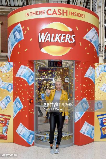 Olivia Buckland visits the Walkers Cash Dash at London's Victoria Station to celebrate Walkers' Pay Packets on April 25 2017 in London England
