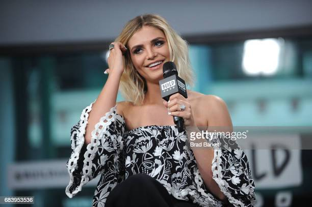Olivia Caridi discusses the 'Bachelorette' with the 'Here To Make Friends' Podcast at Build Studio on May 16 2017 in New York City