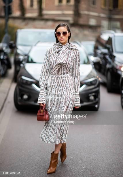 Olivia Clupo is seen wearing dress outside Ferragamo on Day 4 Milan Fashion Week Autumn/Winter 2019/20 on February 23, 2019 in Milan, Italy.