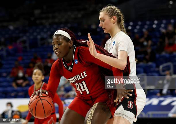 Olivia Cochran of the Louisville Cardinals tries to get past Cameron Brink of the Stanford Cardinal in the first half during the Elite Eight round of...