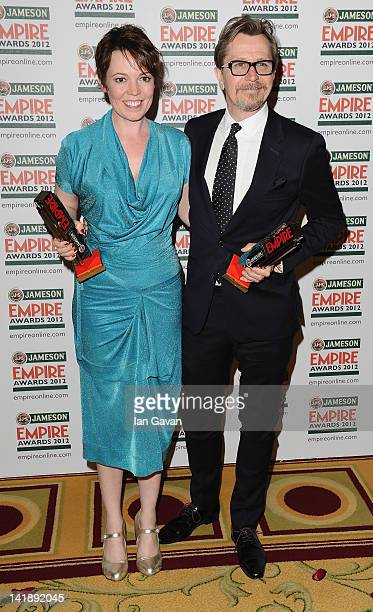 Olivia Colman and Gary Oldman during the 2012 Jameson Empire Awards at the Grosvenor House Hotel on March 25 2012 in London England