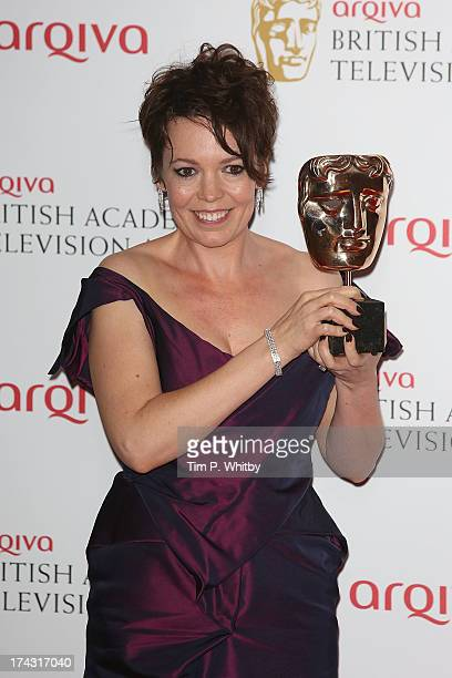 Olivia Colman poses in the press room with her award for Best Supporting Actress at the Arqiva British Academy Television Awards 2013 at the Royal...