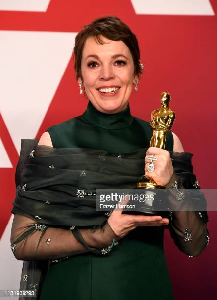 """Olivia Colman, winner of Best Actress for """"The Favourite,"""" poses in the press room during the 91st Annual Academy Awards at Hollywood and Highland on..."""