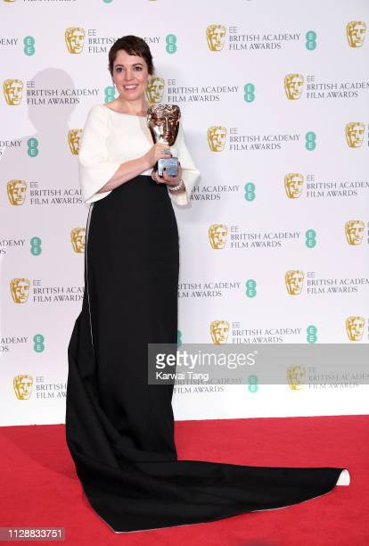 Olivia Colman winner of Best Actress for the film The Favourite poses with her award in the press room during the EE British Academy Film Awards at...
