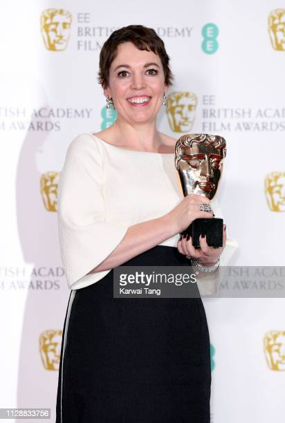 Olivia Colman, winner of Best Actress for the film The Favourite poses with her award in the press room during the EE British Academy Film Awards at...