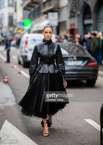 Olivia Culp wearing black dress and jacket attends the Ermanno Scervino show at Milan Fashion Week Autumn/Winter 2019/20 on February 23 2019 in Milan...