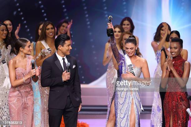 Olivia Culpo and Mario Lopez speak onstage at the 69th Miss Universe competition at Seminole Hard Rock Hotel & Casino on May 16, 2021 in Hollywood,...