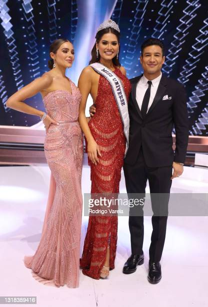 Olivia Culpo and Miss Universe 2020 Andrea Meza and Mario Lopez pose onstage at the 69th Miss Universe competition at Seminole Hard Rock Hotel &...