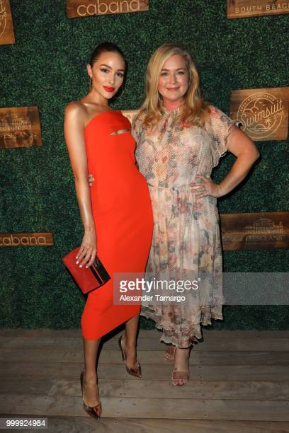 Olivia Culpo and MJ Day attend the 2018 Sports Illustrated Swimsuit show at PARAISO during Miami Swim Week at The W Hotel South Beach on July 15 2018...