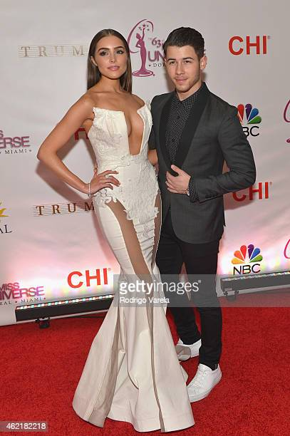 Olivia Culpo and Nick Jonas attend The 63rd Annual Miss Universe Pageant at Trump National Doral on January 25 2015 in Doral Florida