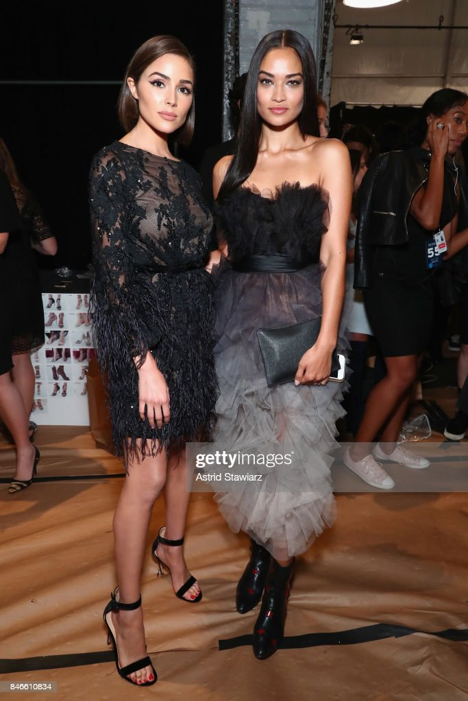 Olivia Culpo and Shanina Shaik pose backstage for the Marchesa fashion show during New York Fashion Week: The Shows at Gallery 1, Skylight Clarkson Sq on September 13, 2017 in New York City.