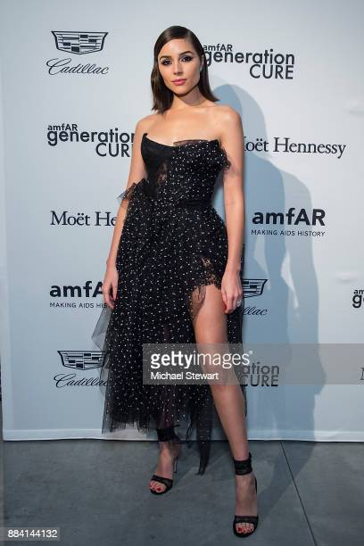 Olivia Culpo attends the 2017 amfAR generationCURE holiday party at the Cadillac House on December 1 2017 in New York City