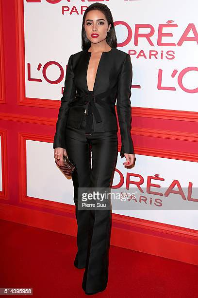 Olivia Culpo attends the L'Oreal Red Obsession Party Photocall as part of the Paris Fashion Week Womenswear Fall/Winter 2016/2017 on March 8 2016 in...