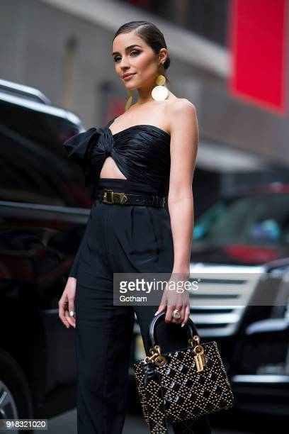 Olivia Culpo is seen wearing a Jacquemus coat Johanna Ortiz jumpsuit with Jimmy Choo shoes and a Dior handbag in Midtown on February 14 2018 in New...