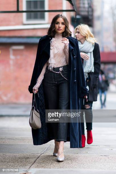 Olivia Culpo is seen wearing a Nina Ricci coat Philosophy top Miaou jeans with Francesco Russo shoes in the West Village on January 30 2018 in New...